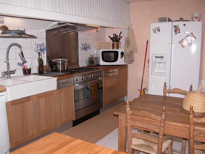 Notre cuisine mur rouge et tout inox dont l 39 lot geant for Inox mur cuisine