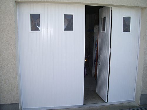 Fuite porte garage 15 messages for Fabrication porte garage bois 2 vantaux